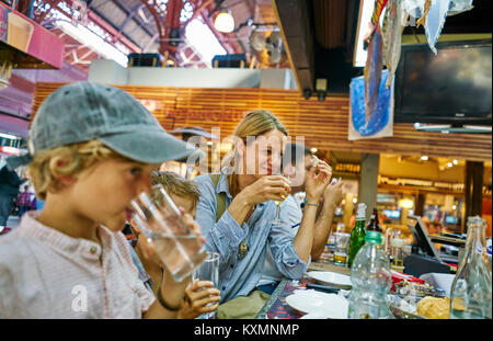 Family having lunch together in restaurant,Montevideo,Uruguay,South America - Stock Photo