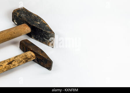 A set of two old and worn hammers isolated on white background