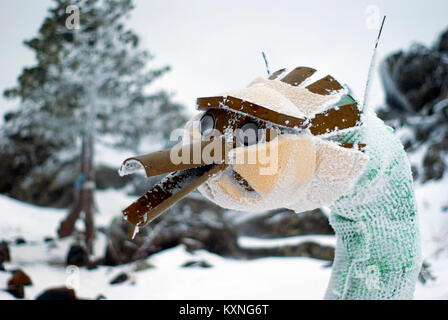 KACHKANAR, RUSSIA - JANUARY 09, 2018: frosted carcass of the head of the unfinished statue of the Eastern Dragon - Stock Photo