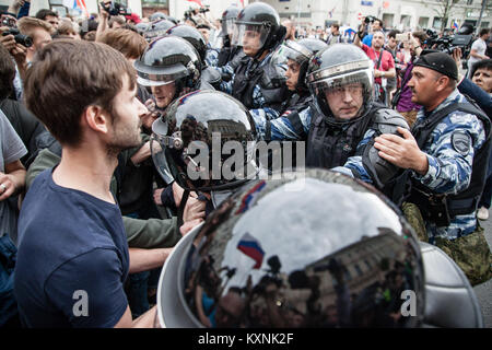 Moscow, Russia. 12th June, 2017. Protesters seen clashing with the police.Anti-corruption protest organised by opposition - Stock Photo