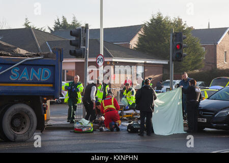 Southport, Merseyside, UK. 11th Dec, 2018. Police & Ambulance crews attend serious road accident in Cambridge road where it is thought a heavy goods lorry has been in a collision with a female pedestrian crossing the road. Emergency staff are rendering immediate first aid to the victim prior to evacuation by air ambulance. Credit: MediaWorldImages/Alamy Live News