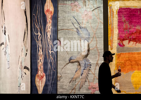 Hanover, Germany. 11th Jan, 2018. Designer carpets are displayed on walls at the exhibition halls for the world - Stock Photo