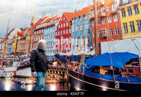 Hanover, Germany. 11th Jan, 2018. Visitors walk past wall hangings displayed at the exhibition halls for the world - Stock Photo
