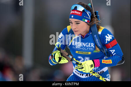 Ruhpolding, Germany. 11th Jan, 2018. Biathlete Dorothea Wierer from Italy jumps into the race at Chiemgau Arena - Stock Photo
