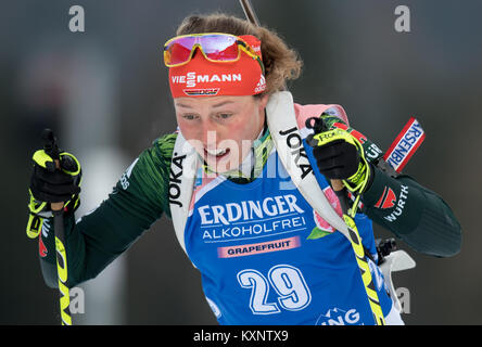 Ruhpolding, Germany. 11th Jan, 2018. Biathlete Laura Dahlmeier from Germany jumps into the race at Chiemgau Arena - Stock Photo