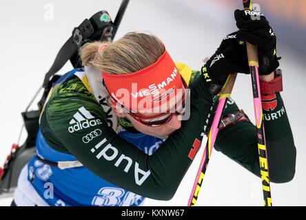 Ruhpolding, Germany. 11th Jan, 2018. Biathlete Franziska Hildebrand from Germany crosses the finish line at Chiemgau - Stock Photo