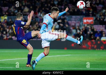 Barcelona, Spain. 11th Jan, 2018. FC Barcelona's Jordi Alba (L) vies for the ball with Celta's Emre Mor during the - Stock Photo