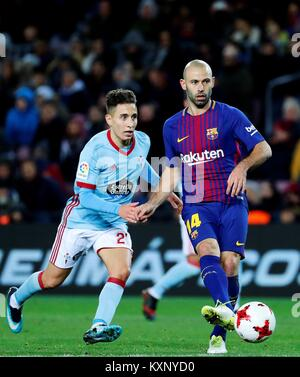 Barcelona, Spain. 11th Jan, 2018. FC Barcelona's Mascherano (R) vies for the ball with Celta's Emre Mor during the - Stock Photo