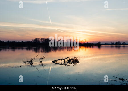 Beautiful sunset in early macrh at Wilstone Reservoir in Hertfordshire, England, now a nature reserve. - Stock Photo