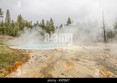 Silex Spring is in the Lower Geyser Basin in Yellowstone National Park - Stock Photo