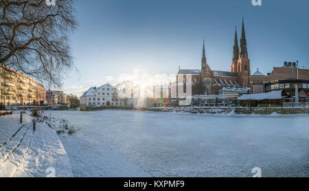 Old mill at Kvarnfallet in the Fyris river with the Cathedral (Domkyrkan) in the background. Uppsala, Sweden, Scandinavia - Stock Photo