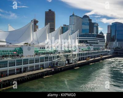 Cruise liner leaving Canada Place in Vancouver Harbour - Stock Photo