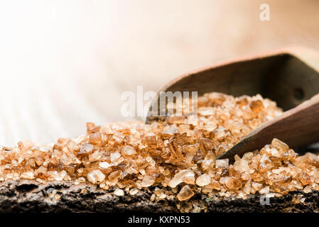wooden scoop with smoked salt on table - Stock Photo