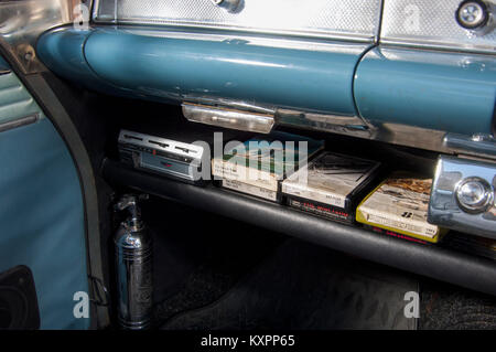 Eight Track tapes in a classic car dashboard - Stock Photo