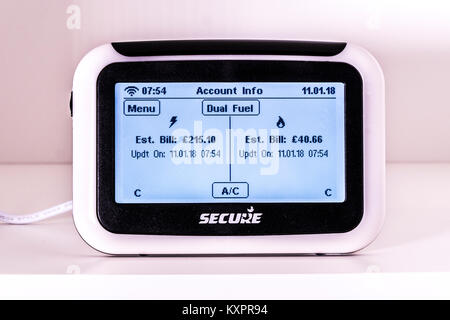 Dual fuel smart meter by Secure, with lighted display showing user account of estimated pounds sterling bills for - Stock Photo