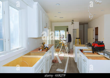 Contractor Using Circular Saw Cutting New Crown Moulding for Renovation. - Stock Photo