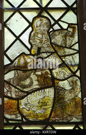UK, England, Oxfordshire, Kelmscott, St George's Church, chancel, 1430 stained glass window showing Saint George - Stock Photo