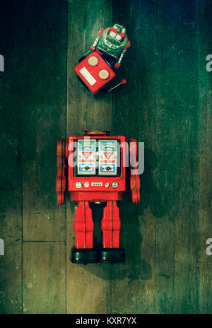 concept fixing your head with rteo robot toys on old wooden floor - Stock Photo