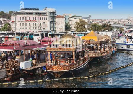 ISTANBUL, TURKEY - SEPTEMBER 09, 2014: Traditional floating fish restaurants at the Eminonu pier on September 09, - Stock Photo