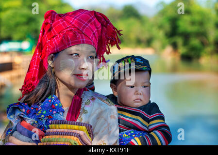 Tribal woman in Inle village selling cloths, Myanamar - Stock Photo