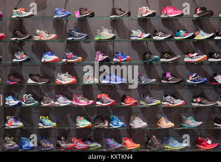 A display of women's athletic running shoes at Paragon Sports a sporting goods supermarket on Broadway in Manhattan, - Stock Photo