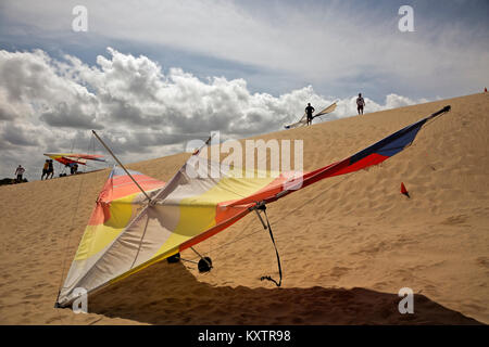 NC01253-00...NORTH CAROLINA - Hand glider school on the sand dunes at Jockey's Ridge State Park on the Outer Banks - Stock Photo