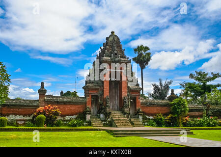 A roofed tower gate (kori agung), which is the entrance to the temple's inner sanctum of Pura Taman Ayun in Mengwi, - Stock Photo