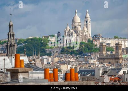 Montmartre Paris cityscape, view across roofs in the center of Paris towards Montmartre with the Sacre Coeur Church - Stock Photo