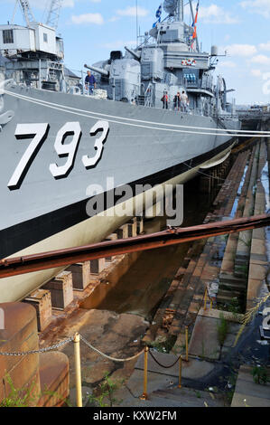 WW II destroyer USS Cassin Young in dry dock at the Charlestown Navy Yard, home of the USS Constitution Museum - Stock Photo