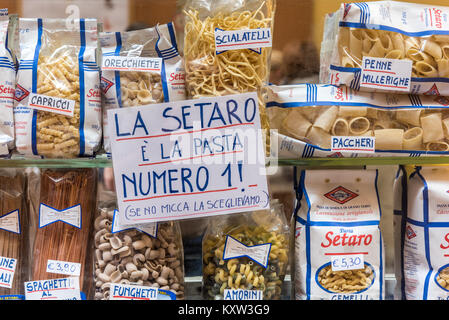 Pasta for sale in a shop window in Bologna Italy - Stock Photo