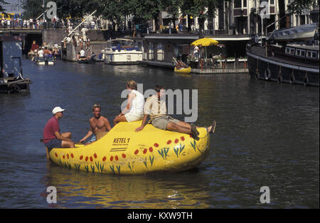 The Netherlands. Amsterdam. Little boat in shape of clog. - Stock Photo