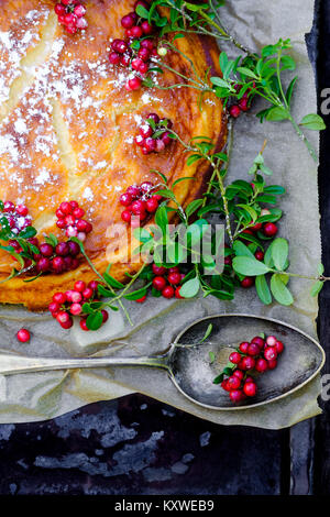 Easy white chocolate cheesecake and cranberries from forest - Stock Photo