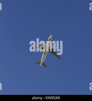 Plane flying with clearly sky - Stock Photo