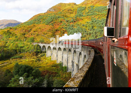 Picture taken from on the Jacobite Express steam train passing over the Glenfinnan Viaduct on the West Highland - Stock Photo