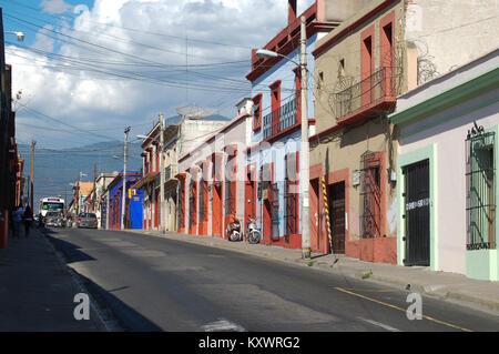 A street in the center of the city of Oaxaca with typical  colourful Spanish colonial  houses on the background, - Stock Photo