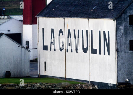 Close up of the outside of Lagavulin Whisky Distillery big black letters on whitewashed walls, Isle of Islay, Scotland - Stock Photo