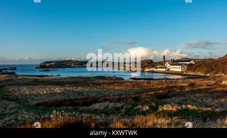 Beautiful landscape of Lagavulin Whisky Distillery in the bay on a sunny day, Isle of Islay, Scotland - Stock Photo