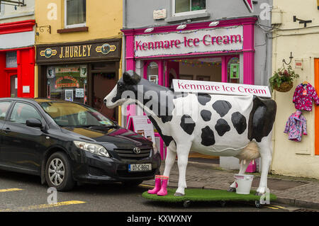 Plastic cow on display advertising the Kenmare Ice Cream Parlour in Kenmare, County Kerry, Ireland. - Stock Photo