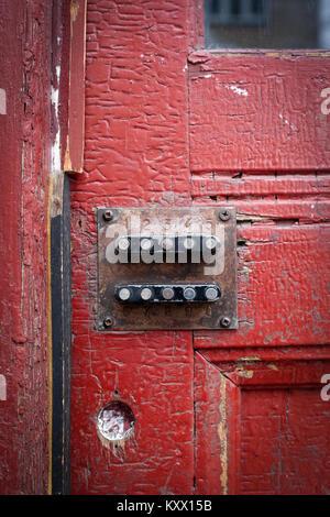 Old code lock on the door. Rust, cracked color - Stock Photo