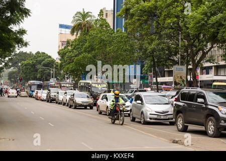 A long queue of vehicles wait on Kenyatta Avenue during a normal weekday, Nairobi, Kenya - Stock Photo