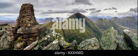 The summit cairn of Tom na Gruagaich - Stock Photo