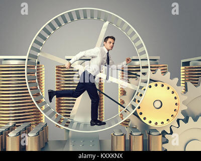 young man run in abstract 3d hamster wheel - Stock Photo