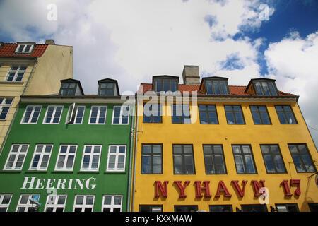 COPENHAGEN, DENMARK - AUGUST 14, 2016: Restaurant 'Heering' and tourist cafe 'Nyhavn 17' on the waterfront of Nyhav - Stock Photo
