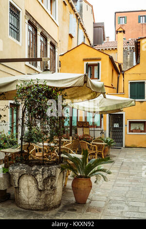An outdoor restaurant along the Grand Canal in Veneto, Venice, Italy, Europe, - Stock Photo