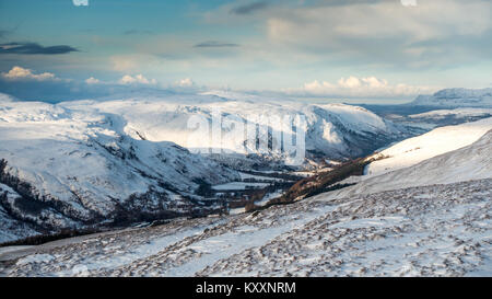 Winter view down Loch Broom to the coast from the snowy mountain Meall Doire Faid (a Graham), Wester Ross, Scottish - Stock Photo