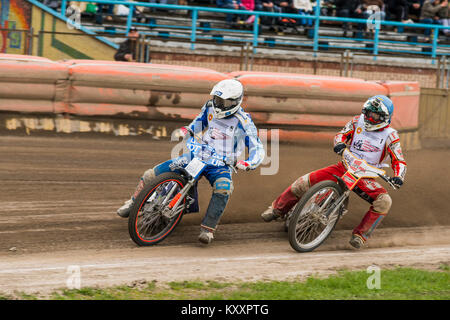 Rivne, Ukraine - 11 Oktober 2015: Two unknown riders overcomes the track at the Open Cup Speedway to the day of - Stock Photo