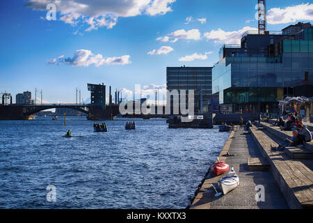 Copenhagen, Denmark – August  16, 2016: People relax in one of the waterfront and views of cities and bridges from - Stock Photo