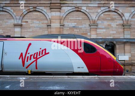 Virgin Trains Pendolino locomotive to London Euston  on West Coast Main line  at platform at Waverley Station in - Stock Photo