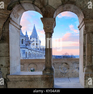 Fisherman's Bastion in Budapest, Hungary. Early morning sky and one of the towers through open windows of another - Stock Photo