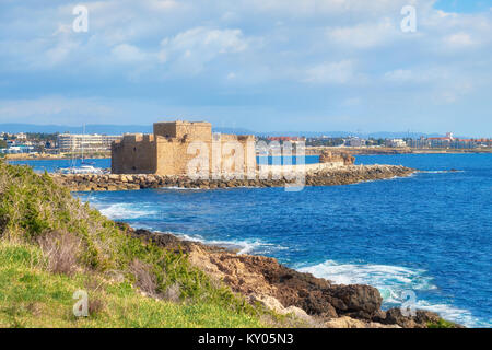 Pafos Harbour Castle, also known as 'Turkish Castle' in Pathos, Cyprus, shot taken from the grassy slope - Stock Photo